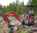 Lander-Sinks-Brewers-Trail-062918-04-Adam-Buck-master-trail-builder-moves-boulder-with-thumb-on-mini-ex