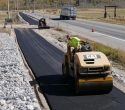 100415-WY-22-Grand-Opening-Rolling-fresh-asphalt-WY-22-Pathway
