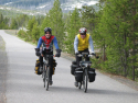 cyclists-on-old-faithful-pathway